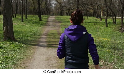 girl running in the park