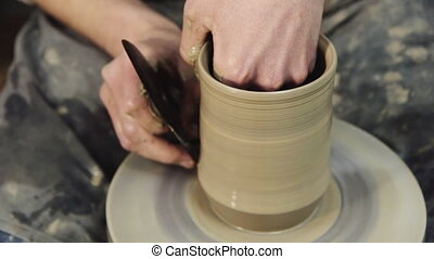 Hand-made: a potter makes a pot of clay - Hand-made - a...