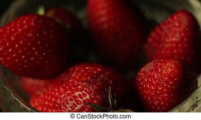 heap of strawberries on dark background