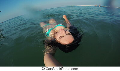 Girl under water of sea - Slow motion video girl diving...