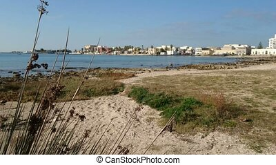 Empty beach in winter in Porto Cesareo, a famous tourist...