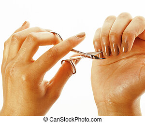 woman hands making no qualified manicure, pedicure to herself isolated with tools