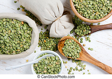Lentil seeds - Top view of spoons and bowls full of green...