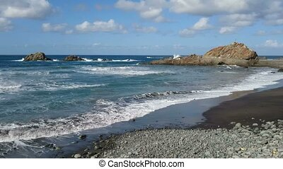 Rocks on the coast of Tenerife - Rocks in the ocean beside...