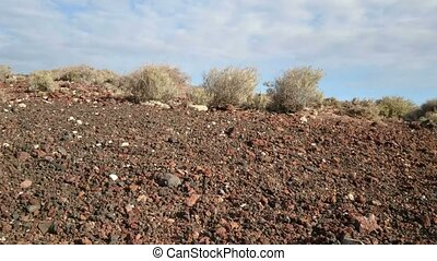 Volcanic rock in desert environment - Volcanic rocks in...