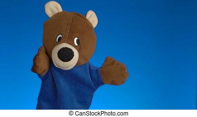 Teddy Bear Puppet Toy over blue background - Teddy Bear Toy...