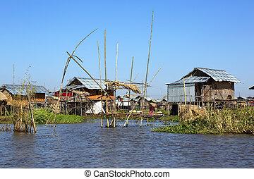 Stilted houses in village on Inle lake, Myanmar Burma