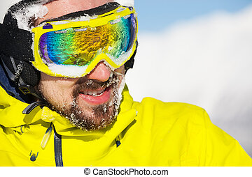 Man in ski mask and snow on beard - Close-up portrait of a...
