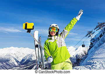 Happy skier woman take selfie with phone on stick - Woman...