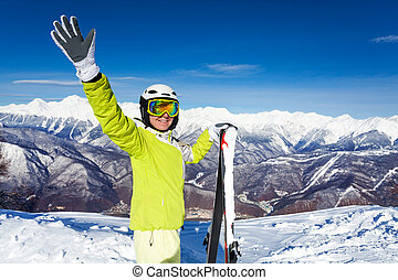 Skier woman wave hand and hold ski - Close portrait of woman...