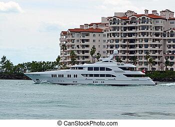 Luxurious Mega Yacht - Luxurious motor yacht cruising by a...