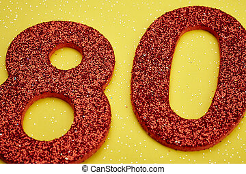 Number eighty red color over a yellow background....