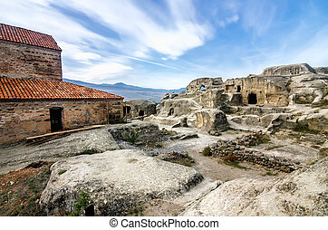 Uplistsikhe is an ancient rock-hewn town in eastern Georgia,...