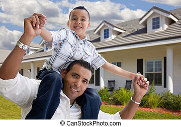 Hispanic Father and Son in Front of House - Playful Hispanic...