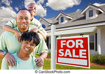 African American Family with For Sale Sign and House