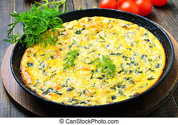 Omelette in frying pan on wooden table, close up