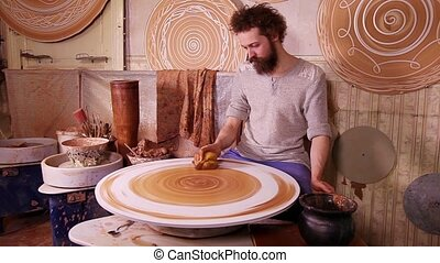 Fast motion video of a Potter worki - Fast motion video shot...