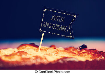 cake with text joyeux anniversaire, happy birthday in french...
