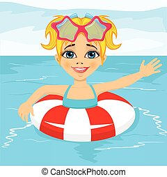 cute little girl swimming in pool with inflatable ring -...