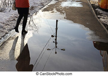 girl and reflection spring - girl goes on the sidewalk in a...