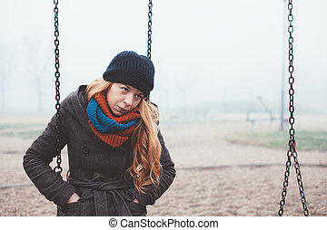 Lonely woman in the playground
