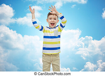 happy little boy waving hands - childhood, fashion, joy and...
