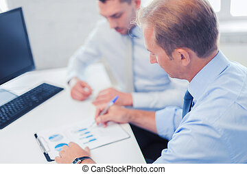 businessmen with notebook on meeting - businesss and office...