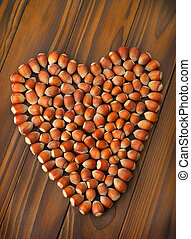 hazelnut - heart, hazelnut on a brown table