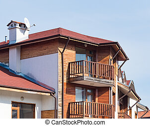 gable house with a roof - part of the house with a balcony...