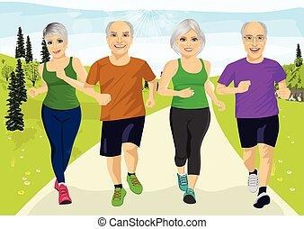 group of senior runner men and women running together...
