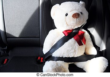 fasten your seat belt concept with teddy bear showing car...
