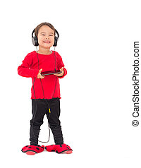 Little girl listening music with headphones, isolated on...