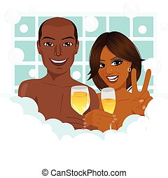 A young african american couple taking a bath with champagne