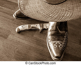 Cowboy Hat, Boots, Knife - Close up of straw cowboy hat,...