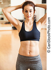 Beautiful athletic woman at the gym - Portrait of a strong...