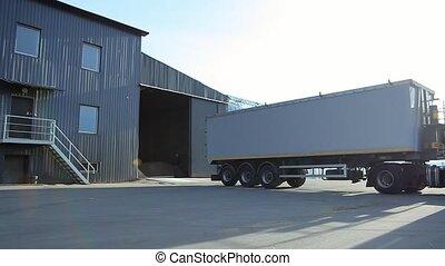 Truck Unloading Grain into Elevator. - Unloading corn into...