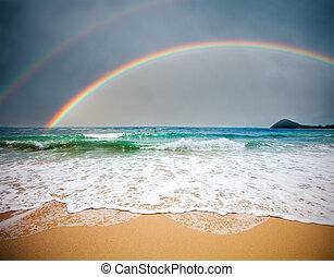 stormy sea and cloudy sky with rainbow