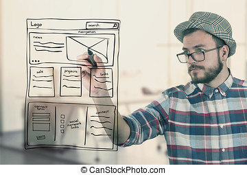 web designer drawing website development wireframe at office