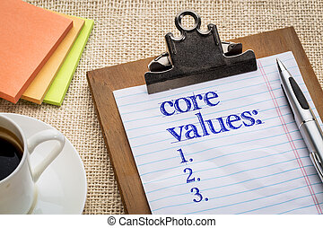 core values list on clipboard with a pen, coffee and sticky...