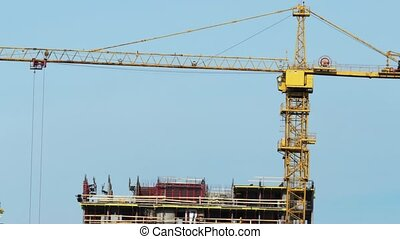 Yellow tower crane time lapse zoom in