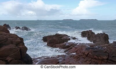 The Pink Granite Coast France - Waves breaking on coastal...
