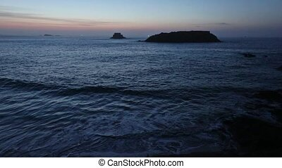 Night Ocean Scenery - Night ocean scenery with pink sky and...
