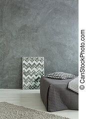Keeping the decor simple - Shot of a grey bedroom in a...