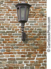 Old lantern on the brick wall - Old lantern