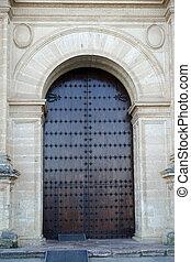 Church Door - Old wooden entrance door of the Colegiata de...