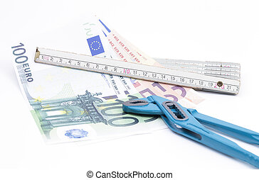 Folding rule with money and pliers - Image shows a yardstick...