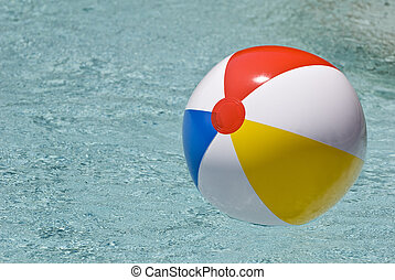 Beach Ball Floating In Swimming Poo