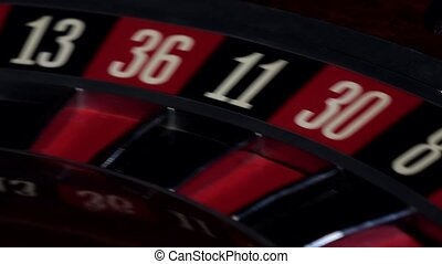 Roulette wheel running, numbers, close up - Usual roulette...