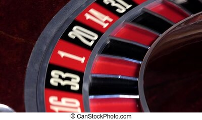 Roulette wheel running and stops with fallen white ball -...