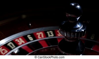 Roulette wheel running and stops with white ball on 20 -...